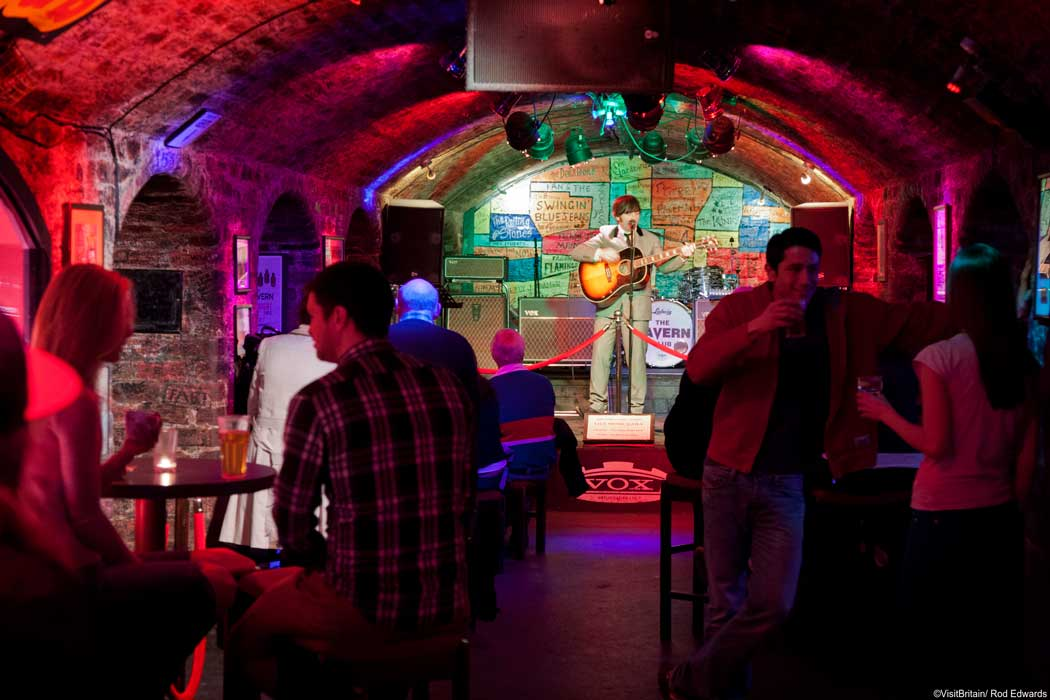 In the early 1960s, The Beatles played almost 300 gigs at the Cavern Club on Matthew Street in Liverpool. You can recreate the experience by visiting the Cavern Club to see their in-house Beatles tribute band. (Photo © VisitBritain/Rod Edwards).