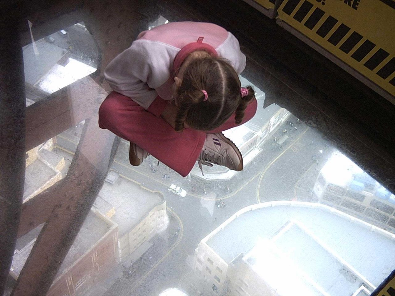 Sitting on the glass floor on the Blackpool Tower Eye observation deck at the top on the Blackpool Tower (Photo: Neil Gray)