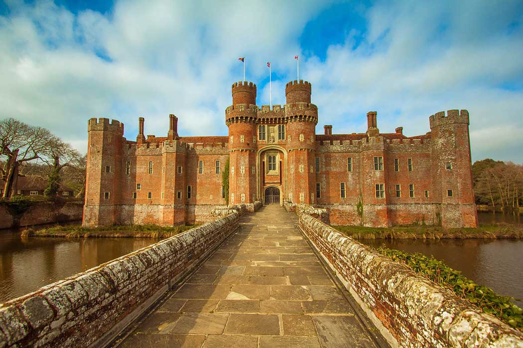 The 15th-century Herstmonceux Castle is surrounded by a moat on three sides
