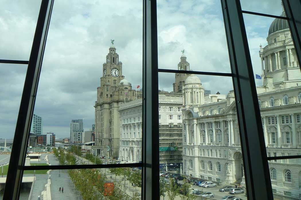 There is a great view of the Three Graces on Pier Head from the People's Republic gallery at the Museum of Liverpool. (Photo: Nathan Stazicker [CC BY-SA 3.0])