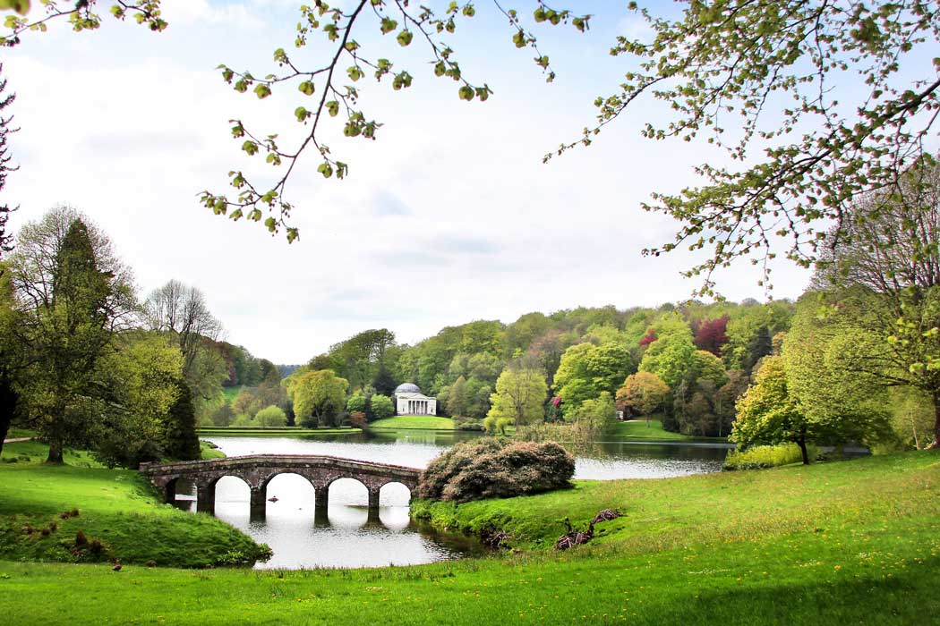 Stourhead Gardens is considered the most beautiful landscape garden to have been designed in the 18th century. Its design features an artificially-created lake and it is heavily influenced by the Italian landscape. Here you can see the Palladian Bridge with the Pantheon in the background.