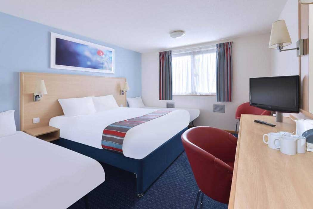 Family rooms have a king-size bed plus one or two pull-out beds. (Photo © Travelodge)